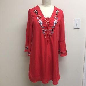 Embroidered coral dress with three-quarter sleeve